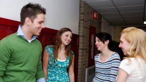 Teens standing in a school hallway